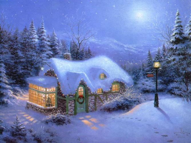 Karácsonyi fényben lévő havas házikó.