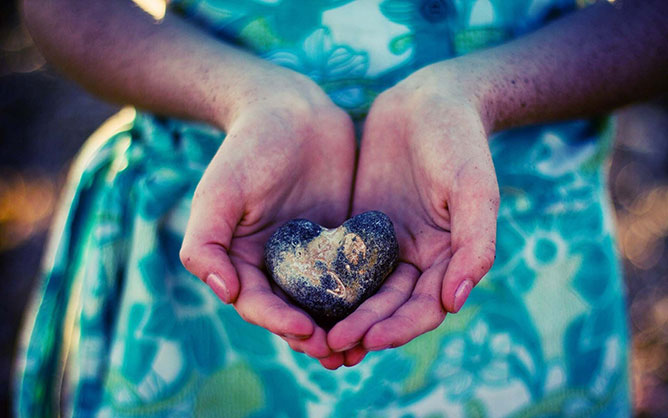 stone heart in hand.
